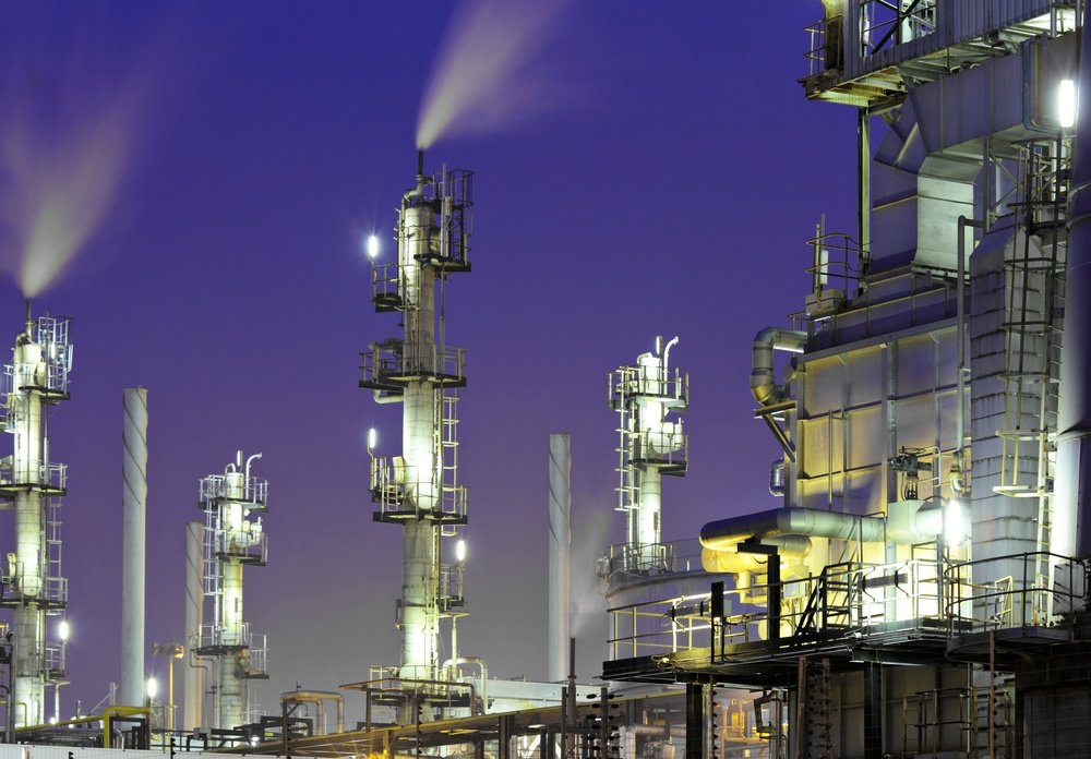 Oil refinery plant at night.jpeg